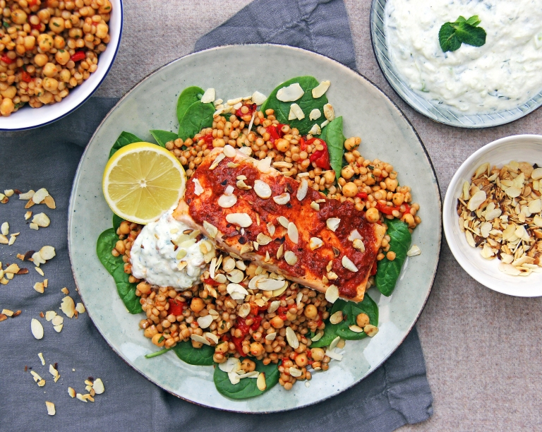 harissa-roasted-salmon-with-moroccan-spiced-giant-couscous-chickpeas-toasted-almonds-and-tzatziki