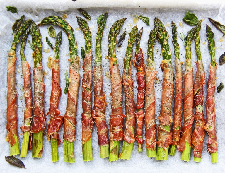 Grilled asparagus wrapped in crispy prosciutto with sage and Parmesan